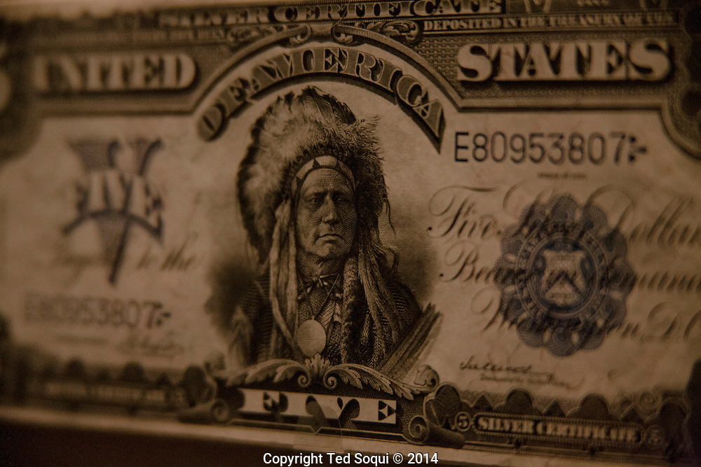 The nation's capitol, Washington, DC.<br /> The first five dollar bill, which featured a American Indian that was eventually replaced by an image of President Lincoln.