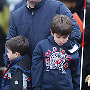 Father Bujar hugs his sons Ernest, 7, and Redon, 4.from Westchester, New York,  at the shrine set up around the towns Christmas tree in Sandy Hook after the mass shootings at Sandy Hook Elementary School, Newtown, Connecticut, USA. 17th December 2012. Photo Tim Clayton