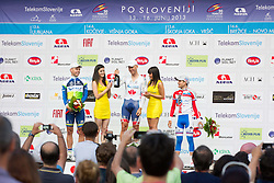 Second placed Brett Lancaster (Aus) Orica-GreenEdge, winner Svein Tuft (CAN) of Orica-Green Edge and third placed Artem Oveckin (Rus) RusVelo celebrates during flower ceremony after the Stage 1of  cycling race 20th Tour de Slovenie 2013 - Time Trial 8,8 km in Ljubljana,  on June 12, 2013 in Slovenia. (Photo By Vid Ponikvar / Sportida)