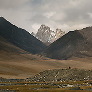"""Afghan Pamir mountains. From Sang Nevishta valley into the Shpodkis valley to below the Gorumdee Pass. Guiding and photographing Paul Salopek while trekking with 2 donkeys across the """"Roof of the World"""", through the Afghan Pamir and Hindukush mountains, into Pakistan and the Karakoram mountains of the Greater Western Himalaya."""