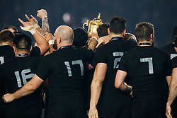 The Webb Ellis Cup can just be seen as players huddle around it after New Zealand win the match 34-17 to become 2015 World Cup Champions - Mandatory byline: Rogan Thomson/JMP - 07966 386802 - 31/10/2015 - RUGBY UNION - Twickenham Stadium - London, England - New Zealand v Australia - Rugby World Cup 2015 FINAL.