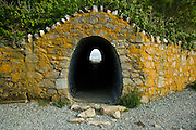 USA, Newport, RI - The last Cliff walk tunnel on the way out to Rough Point goes beneath the lawn of Miramar mansion.