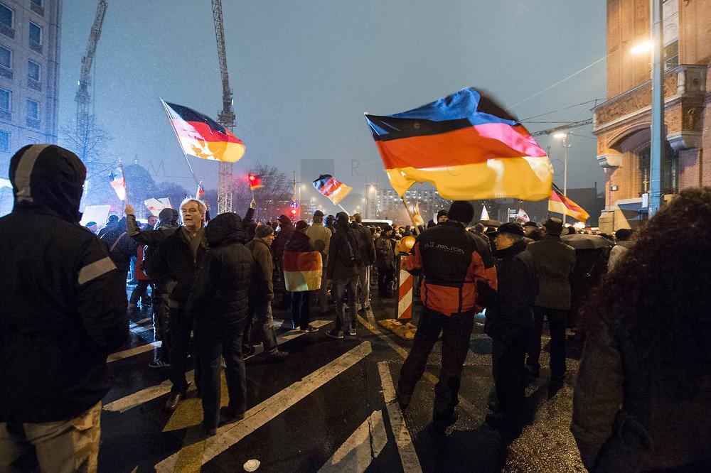 "05 JAN 2015, BERLIN/GERMANY:<br /> Demonstranten mit Deutschland-Fahnen, Bärgida-Demo ""Berliner Patrioten gegen die Islamisierung des Abendlandes"", Spandauer Strasse<br /> IMAGE: 20150105-01-044<br /> KEYWORDS: Bärgida, Demonstranten, Protest, Demonstration, Flaggen"