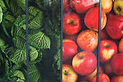 Large scale pictures of fresh fruit and vegetables outside a supermarket in London, England, United Kingdom. Apples and cabbages are represented to entice in custom with their fresh look.