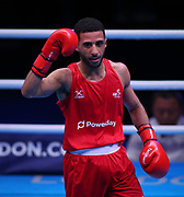 Galal Yafai of Great Britain (red) celebrates beating Rasul Saliev of Russia (bue) competing in the Men's Featherweight preliminaries during The Road to Tokyo European Olympic Boxing Qualification, Sunday, March 15, 2020, in London, United Kingdom. (Mitchell Gunn-ESPA-Images/Image of Sport)