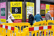 Elderly people walking past the sale signs outside the Folkestone Debenhams store in the final few days of the 'Everything Must Go' sale before closing down in Folkestone, Kent. United Kingdom. The company announced the closure of 19 stores across the UK after going into administration in 2019.  (photo by Andrew Aitchison / In pictures via Getty Images)