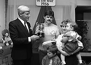 Heinz / Woman's Way, Baby of the Year..1986..21.11.1986..11.21.1986..21st November 1986..The 19th Annual 'Baby of the Year' awards ceremony took place at the Zoological Gardens,Dublin..Baby, Alan Smith from Co Meath was the overall winner.Amy Dempsey from Dublin and Brendan Gallagher from Waterford were placed 2nd and 3rd...Picture of Alan Smith receiving his award of Baby of the Year from Mr John Paul O'Reilly, 'Heinz'. Alan is accompanied by his parents Derek and Eileen Smith and his big brother.The Smiths reside in Dunboyne, Co Meath.