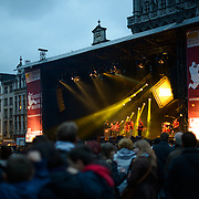 The Belgian band Opmoc plays on a stage at the Brussels Jazz Marathon in the Grand Place, Brussels. Originally the city's central market place, the Grand-Place is now a UNESCO World Heritage site. Ornate buildings line the square, including guildhalls, the Brussels Town Hall, and the Breadhouse, and seven cobbelstone streets feed into it.