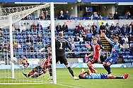 John Akinde (29) scores for Lincoln City as Wycombe Wanderers Matt Bloomfield lies injured on the ground during the EFL Sky Bet League 1 match between Wycombe Wanderers and Lincoln City at Adams Park, High Wycombe, England on 7 September 2019.