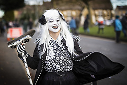 January 14, 2017 - Whittlesey, Cambridgshire, UK - Whittlesey UK. Picture shows a member of the Pig Dyke Molly dancers at the 38th Whittlesey Straw Bear Festival this weekend. In times past when starvation bit deep the ploughmen of the area where drawn to towns like Whittlesey, They knocked on doors begging for food & disguised their shame by blackening their faces with soot. In Whittlesey it was the custom on the Tuesday following Plough Monday to dress one of the confraternity of the plough in straw and call him a Straw Bear. The bear was then taken around town to entertain the folk who on the previous day had subscribed to the rustics, a spread of beer, tobacco & beef. The bear was made to dance in front of houses & gifts of money, beer & food was expected. (Credit Image: © Andrew Mccaren/London News Pictures via ZUMA Wire)