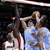 19 March 2011: Denver Nuggets forward Danilo Gallinari (8) goes to the basket against Miami Heat center Joel Anthony (50) during the Miami Heat 103-98 victory over the Denver Nuggets at the AmericanAirlines Arena, Miami, Florida, USA.