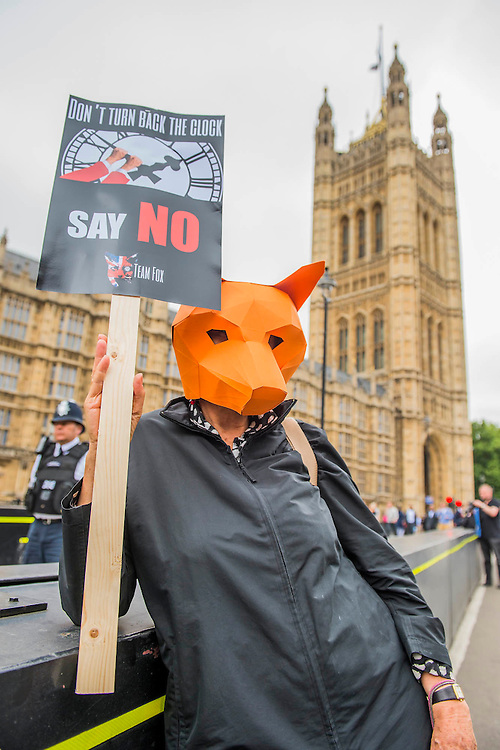 Protestors, with cardboard foxes heads on, briefly block the road - Ahead of Wednesday's free vote, Brian May (Queen guitarist and committed animal campaigner) and Angus Robertson MP, Leader of the SNP in Westminster – along with May's Save Me Trust, PETA, the RSPCA, the League Against Cruel Sports, Born Free, Lush and Humane Society International – protest in Westminster, urging policymakers to 'keep Britain humane by keeping the Hunting Act intact'. While there they hear that the vote has been postponed.
