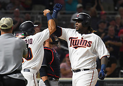 May 31, 2018 - Minneapolis, MN, U.S. - MINNEAPOLIS, MN - MAY 31: Minnesota Twins Third base Miguel Sano (22) celebrates his 3-run home run in the bottom of the 7th with Minnesota Twins Left field Eddie Rosario (20) during a MLB game between the Minnesota Twins and Cleveland Indians on May 31, 2018 at Target Field in Minneapolis, MN. The Indians defeated the Twins 9-8.(Photo by Nick Wosika/Icon Sportswire) (Credit Image: © Nick Wosika/Icon SMI via ZUMA Press)
