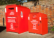 Red British Heart Foundation charity collecting containers for clothing, books and music, UK