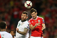 Daryl Murphy of Republic of Ireland (l) jumps for a header with Ben Davies of Wales. Wales v Rep of Ireland , FIFA World Cup qualifier , European group D match at the Cardiff city Stadium in Cardiff , South Wales on Monday 9th October 2017. pic by Andrew Orchard, Andrew Orchard sports photography
