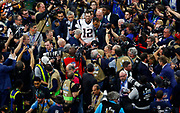 Tom Brady is mobbed by the media after Super Bowl LIII.