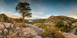 """""""Donner Summit Sunset 2"""" - Stitched panoramic sunset photograph of Truckee, Donner Lake, Rainbow Bridge, and Donner Summit. A carved heart can be seen on the tree in the foreground."""