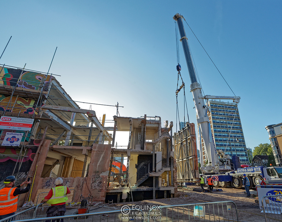 London, United Kingdom - 20 September 2019<br /> EXCLUSIVE SET - Aerial construction specialists and demolition experts use a huge crane to carefully lift intact, a twenty five ton, two-story wall, to preserve a famous Banksy rat image which has been covered up for years. Teams from specialist companies have spent over six weeks cutting around the artwork and fitting custom made eight ton steel supports to enable them to save the historic piece of art. Work has started on the construction of a new twenty seven floor art'otel hotel on the site of the old Foundry building in Shoreditch, east London, and a condition of the planning permission was to preserve the historical Banksy graffiti. A second section of the painting, an image of a TV being thrown through a broken window has already been cut out and moved separately. After the hotel construction is complete the two parts of the Banksy painting will be displayed on the hotel. Our pictures show the stages of work to protect the image, culminating in the lifting of the three story wall by crane. Video footage also available.<br /> (photo by: EQUINOXFEATURES.COM)<br /> Picture Data:<br /> Photographer: Equinox Features<br /> Copyright: ©2019 Equinox Licensing Ltd. +443700 780000<br /> Contact: Equinox Features<br /> Date Taken: 20190920<br /> Time Taken: 17122695<br /> www.newspics.com
