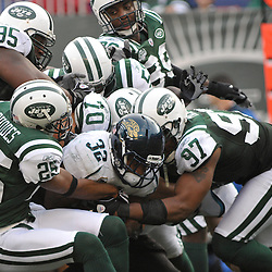 Nov 15, 2009; East Rutherford, NJ, USA; Members of the New York Jets defense gang-tackle Jacksonville Jaguars running back Maurice Jones-Drew (32) during second half NFL action in the Jacksonville Jaguars 24-22 victory over the New York Jets at Giants Stadium.