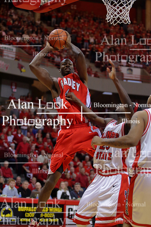 """31 January 2009: David Collins looks at Champ Oguchi as he pulls in a rebound.  The Illinois State University Redbirds join the Bradley Braves in a tie for 2nd place in """"The Valley"""" with a 69-65 win on Doug Collins Court inside Redbird Arena on the campus of Illinois State University in Normal Illinois"""