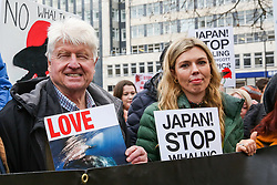 © Licensed to London News Pictures. 26/01/2019. London, UK. Former Foreign Secretary Boris Johnson's girlfriend Carrie Symonds (R) attends the protest against Japanese Whaling demonstration in central London along with Stanley Johnson (L).  Photo credit: Dinendra Haria/LNP