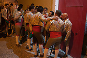 A group of Portugese Forcados stand outside the bullring and show their camaraderie before the evenings bullfight Corrida de Touros, on 15th July 2016, at Caldas da Rainha, Portugal. A forcado is a member of a group of men that performs the pega de cara or pega de caras face catch, the final event in a typical Portuguese bullfight. They were initially professionals from lower classes but nowadays people from all social backgrounds practice their art through amateur groups. Unlike Spanish bullfights, in the Portuguese version, they do not kill the bull.