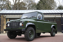 """File photo dated 14/04/21 of the Jaguar Land Rover that will be used to transport the coffin of the Duke of Edinburgh at his funeral on Saturday, pictured at Windsor Castle, Berkshire. The Duke of Edinburgh's project to custom build his own Land Rover hearse spanned 16 years, with Philip requesting a repaint in military green and designing the open top rear and special """"stops"""" to secure his coffin in place. Issue date: Wednesday April 14, 2021."""