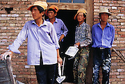 Young plasterers, Guancai village, Ningxia Province, China