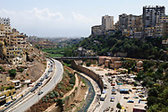 Tripoli, Lebanon - September 7, 2010: Part of the city of Tripoli, including a highway and canal, viewed from the Citadel. Tripoli is the largest city in northern Lebanon and the second largest city in the country after Beirut.