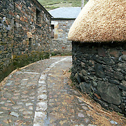 One of the streets of the small village of Balouta, with its traditional houses with straw roofs.