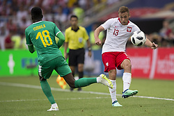June 19, 2018 - Moscow - Maciej Rybus of Poland kicks the ball during the 2018 FIFA World Cup Group H match between Poland and Senegal at Spartak Stadium in Moscow, Russia on June 19, 2018  (Credit Image: © Andrew Surma/NurPhoto via ZUMA Press)