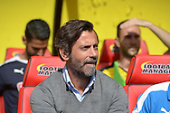 Quique Sanchez Flores, the Watford manager looks on from the dugout before k/o. Barclays Premier League, Watford v Southampton at Vicarage Road in London on Sunday 23rd August 2015.<br /> pic by John Patrick Fletcher, Andrew Orchard sports photography.