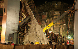 Rescuers work at the collapse site of an under-construction flyover in Kolkata, capital of eastern Indian state West Bengal, March 31, 2016. At least 20 people have been killed and more than 150 others injured in a under-construction flyover collapse in the eastern Indian city of Kolkata Thursday. EXPA Pictures © 2016, PhotoCredit: EXPA/ Photoshot/ Tumpa Mondal<br /> <br /> *****ATTENTION - for AUT, SLO, CRO, SRB, BIH, MAZ, SUI only*****