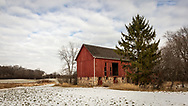 Wisconsin Winterscape: Red barn in snow covered field, just off Valley Road to Oconomowoc, Waukesha, Wisconsin
