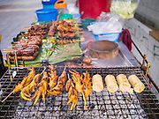 """04 OCTOBER 2012 - BANGKOK, THAILAND: A grilled meat vendor's stand on Sukhumvit Rd in Bangkok, Thailand. Thailand in general, and Bangkok in particular, has a vibrant tradition of street food and """"eating on the run."""" In recent years, Bangkok's street food has become something of an international landmark and is being written about in glossy travel magazines and in the pages of the New York Times.       PHOTO BY JACK KURTZ"""