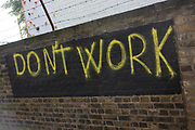 Dont work graffiti in Wapping, London, England, United Kingdom.