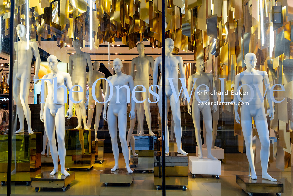 Now under new management, unclothed male mannequins remain crowded together on the shop floor of fashion retailer Topshop on Oxford Street during the third lockdown of the Coronavirus pandemic, on 5th February 2021, in London, England. Asos struck a £295m deal to buy four brands from failed retail group Arcadia. The deal includes brands, Topshop, Topman, Miss Selfridge and HIIT brands, but not the shops, leaving thousands of jobs with uncertain futures.
