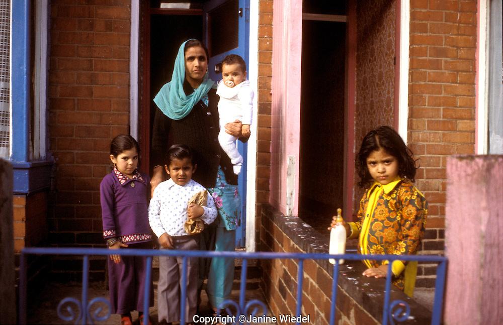 Asian family on their doorstep.
