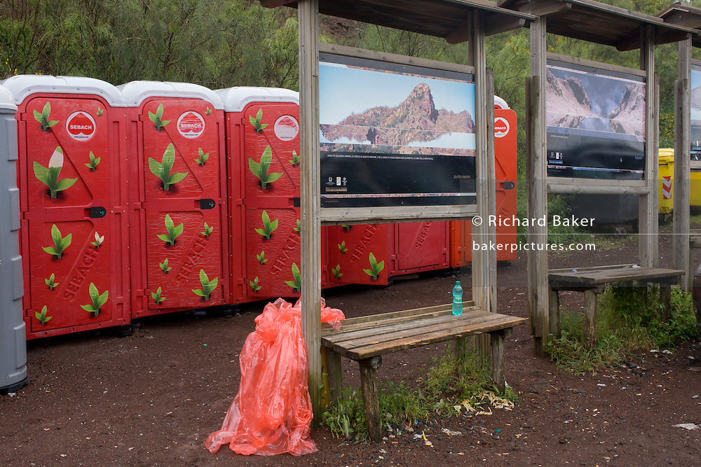 Portaloos in a car park below the crater of Vesuvius volcano.