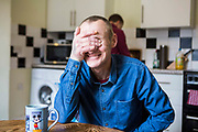 Ian sitting in his kitchen. He was recently living on the streets of Peterborough.  With the help of Hope into Action he is now settled into safe and secure housing and is building connections with his family. Peterborough, Cambridgeshire. UK