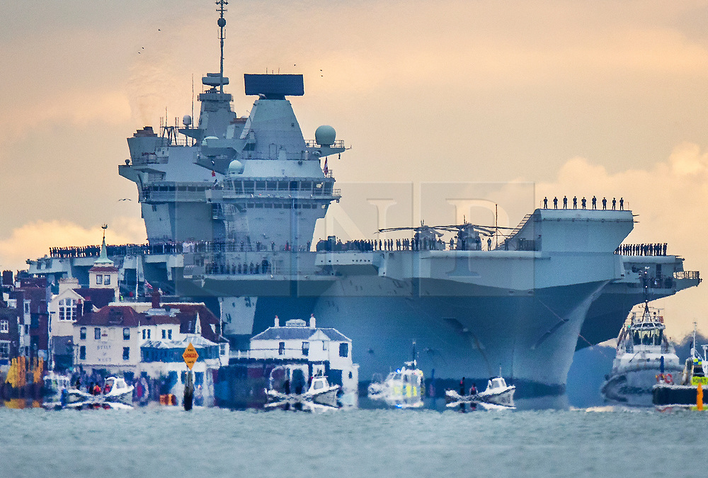 © Licensed to London News Pictures. 16/11/2019. Portsmouth, UK. HMS Prince of Wales, sister aircraft carrier of HMS Queen Elizabeth, sails past Old Portsmouth has it comes into port for the first time. The Royal Navy's  latest aircraft carrier sailed from Rosyth dockyard to begin sea trials in September. The ship, which is 280 metres long and weighs 65,000 tonnes, is expected to commission into the Royal Navy in 2020. Photo credit: Peter Macdiarmid/LNP