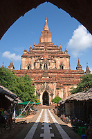 """Sulamani was built in 1181 by Narapatisithu (1174-1211). This temple was known as """"crowing jewel"""" and it stands beyond Dhammayangyi Pagoda. This temple is a more sophisticated temple than the Htilominlo and Gawdawpalin.  Combining the horizontal planes of the early period with the vertical lines of the middle, the temple features two storeys standing on broad terraces assembled to create a pyramid effect. The brickwork throughout is considered some of the best in Bagan. Some part of the temple was damaged during 1975 by the earthquake. Pagodas stand at the corners of each terrace, and a high wall, fitted with elaborate gateways at each cardinal point, encloses the entire complex. The interior face of the wall was once lined with a hundred monastic cells, a feature unique among Bagan's ancient monasteries."""