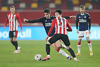 Middlesbrough's Hayden Hackney and Brentford's Alex Gilbert<br /> <br /> Photographer Rob Newell/CameraSport<br /> <br /> The Emirates FA Cup Third Round - Brentford v Middlesbrough - Saturday 9th January 2021 - Brentford Community Stadium - Brentford<br />  <br /> World Copyright © 2021 CameraSport. All rights reserved. 43 Linden Ave. Countesthorpe. Leicester. England. LE8 5PG - Tel: +44 (0) 116 277 4147 - admin@camerasport.com - www.camerasport.com