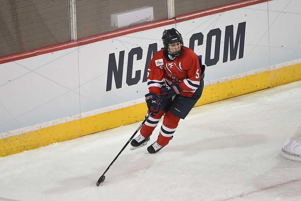 ERIE, PA - MARCH 15: Emily Curlett #5 of the Robert Morris Colonials skates with the puck in the second period during the NCAA Tournament Quarterfinals game against the Northeastern Huskies at the Erie Insurance Arena on March 15, 2021 in Erie, Pennsylvania. (Photo by Justin Berl/Robert Morris Athletics)