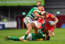 Scarlets' Hadleigh Parkes is tackled by Alberto Sgarbi and Benetton Treviso's Epalahame Faiva - Mandatory by-line: Craig Thomas/JMP - 09/12/2017 - RUGBY - Parc y Scarlets - Llanelli, Wales - Scarlets v Benetton Rugby - European Rugby Champions Cup