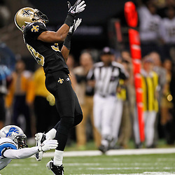 January 7, 2012; New Orleans, LA, USA; New Orleans Saints cornerback Jabari Greer (33) intercepts a pass over Detroit Lions wide receiver Titus Young (16) during the 2011 NFC wild card playoff game at the Mercedes-Benz Superdome. Mandatory Credit: Derick E. Hingle-US PRESSWIRE