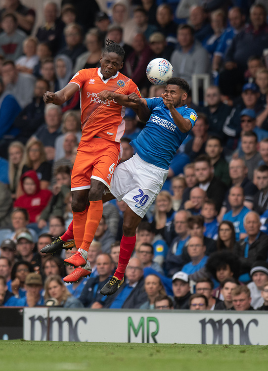 Portsmouth's Nathan Thompson (right) battles with Shrewsbury Town's Omar Beckles (left) <br /> <br /> Photographer David Horton/CameraSport<br /> <br /> The EFL Sky Bet League One - Portsmouth v Shrewsbury Town - Saturday September 8th 2018 - Fratton Park - Portsmouth<br /> <br /> World Copyright © 2018 CameraSport. All rights reserved. 43 Linden Ave. Countesthorpe. Leicester. England. LE8 5PG - Tel: +44 (0) 116 277 4147 - admin@camerasport.com - www.camerasport.com