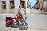 Man and motorcycle in Gibara, Holguin, Cuba.