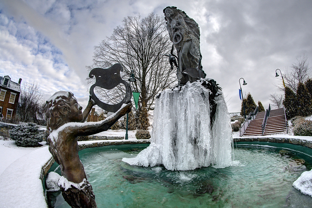 Ice covers the lower half of the statue in the center of the Midsummer Play water fountain at the Barter Theatre in Abingdon, VA on Sunday, January 19, 2014. Copyright 2014 Jason Barnette