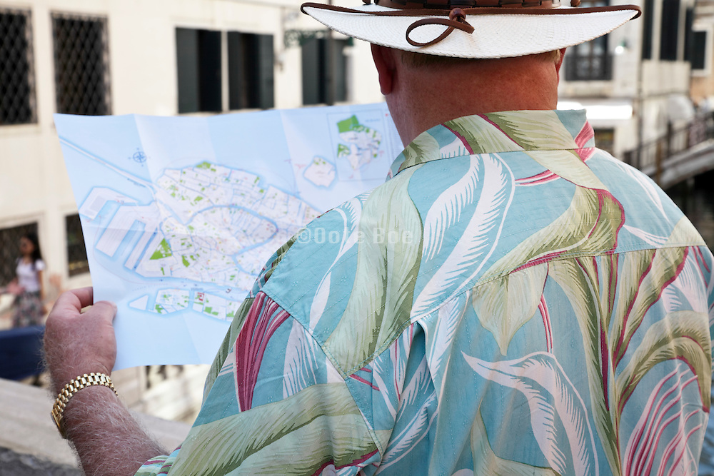 person looking at the Venice city map